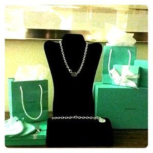 Tiffany oval choker and Tiffany round charm bracel